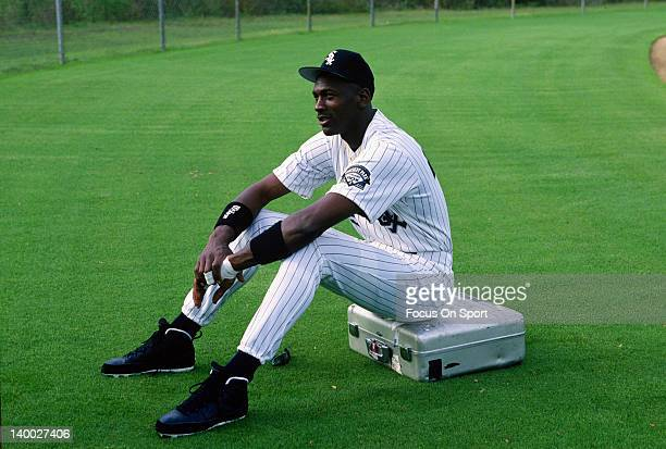 Michael Jordan of the Birmingham Barons the Double A minor league affiliate of the Chicago White Sox sits on a camera case before a photo shoot circa...