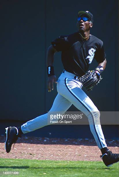 Michael Jordan of the Birmingham Barons the Double A minor league affiliate of the Chicago White Sox tracks a fly ball in the outfield during a minor...