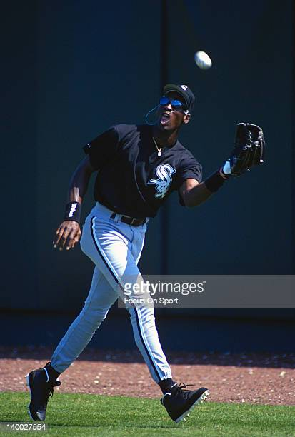 Michael Jordan of the Birmingham Barons the Double A minor league affiliate of the Chicago White Sox catches a fly ball in the outfield during a...
