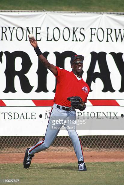Michael Jordan of the Birmingham Barons the Double A minor league affiliate of the Chicago White Sox throws the ball back in from the outfield during...