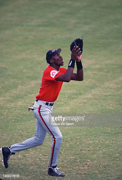 Michael Jordan of the Birmingham Barons the Double A minor league affiliate of the Chicago White Sox catches a fly ball during a minor league...