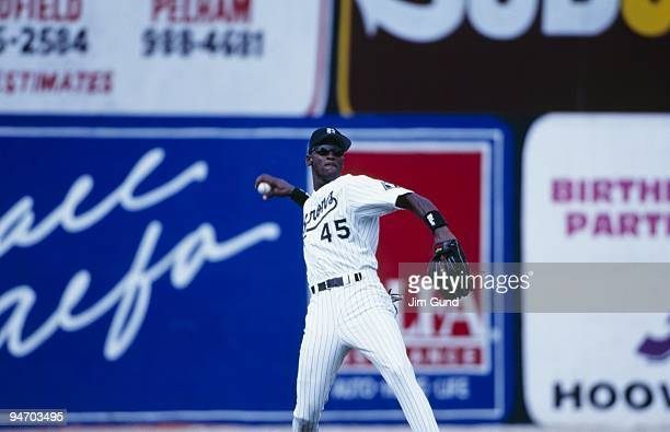 Michael Jordan of the Birmingham Barons throws during an August 1994 game against the Memphis Chicks at Hoover Metropolitan Stadium in Hoover Alabama