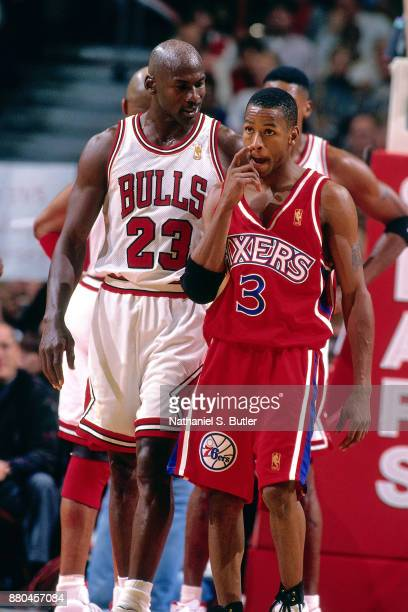 Michael Jordan of the Chicago Bulls and Allen Iverson of the Philadelphia 76ers talk during a game played on November 2 1996 at the United Center in...