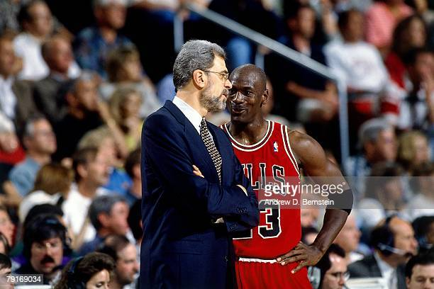 Michael Jordan of the Chicago Bulls and head coach Phil Jackson discuss strategy against the Seattle SuperSonics in Game Three of the 1996 NBA Finals...
