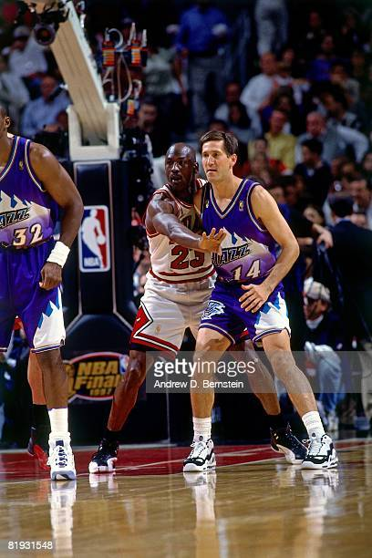 Michael Jordan of the Chicago Bulls and Jeff Hornacek of the Utah Jazz battle for position in Game One of the 1997 NBA Finals at the United Center on...
