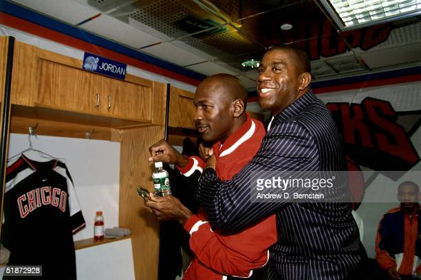 Michael Jordan of the Chicago Bulls and Magic Johnson of the Los Angeles Lakers goof around in the locker room prior to the 1998 NBA AllStar Game at...