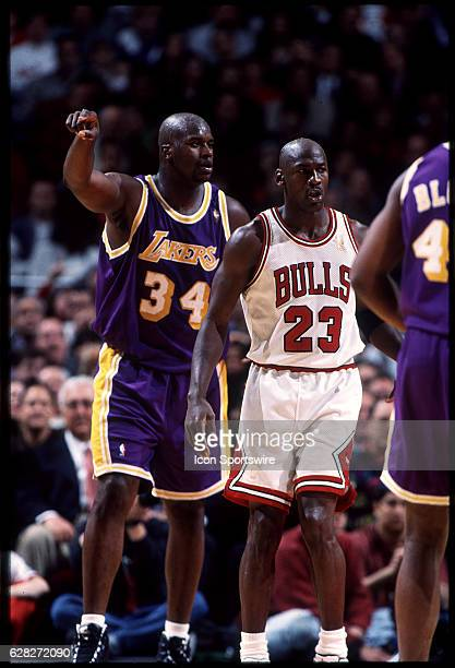 Michael Jordan of the Chicago Bulls and Shaquille O'Neal of the Lakers during the Bulls' game versus the Los Angeles Lakers at the United Center in...