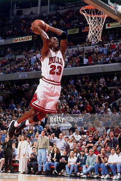 Michael Jordan of the Chicago Bulls attempts a dunk against the Orlando Magic during Game Four of the 1995 Eastern Conference SemiFinals at the...