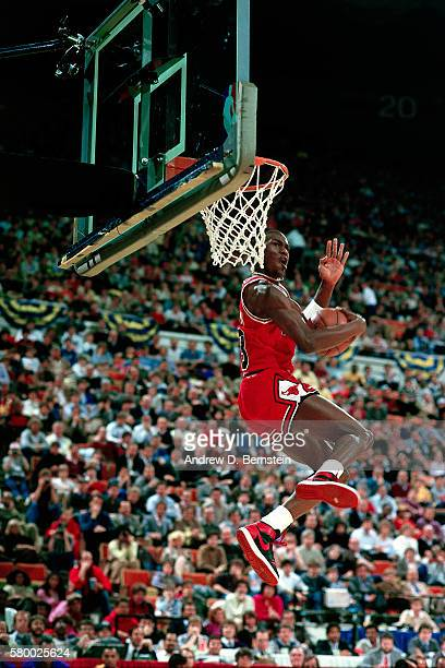 Michael Jordan of the Chicago Bulls attempts a dunk during the 1985 NBA Slam Dunk Contest on February 9 1985 at Market Square Arena in Indianapolis...