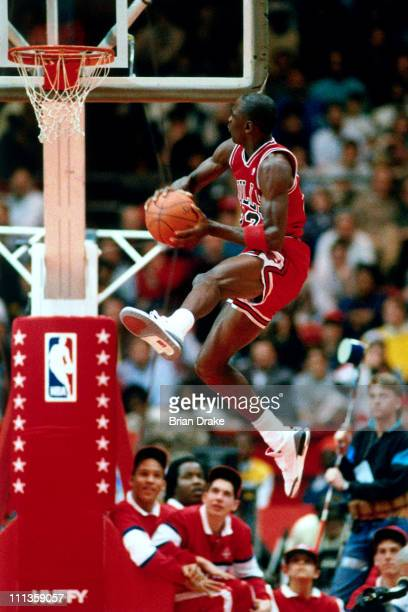 Michael Jordan of the Chicago Bulls attempts a dunk during the 1988 NBA Slam Dunk Contest on February 6 1988 at Chicago Stadium in Chicago Illinois...