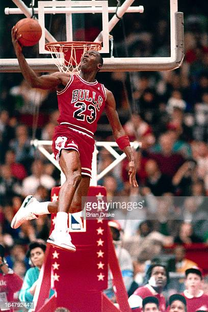 Michael Jordan of the Chicago Bulls attempts a dunk during the 1988 Slam Dunk Contest on February 6 1988 at the Chicago Stadium Chicago Illinois NOTE...