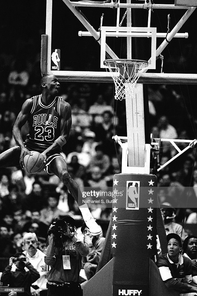 Michael Jordan #23 of the Chicago Bulls attempts a dunk during the 1988 Slam Dunk Contest on February 6, 1988 at Chicago Stadium in Chicago, Illinois.