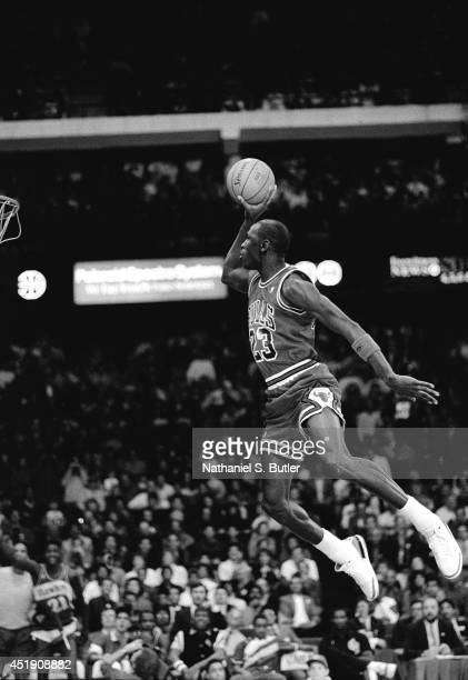 Michael Jordan of the Chicago Bulls attempts a dunk during the 1988 Slam Dunk Contest on February 6 1988 at Chicago Stadium in Chicago Illinois NOTE...