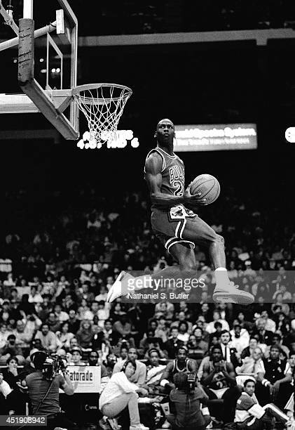 Michael Jordan of the Chicago Bulls attempts a dunk during the 1988 Slam Dunk Contest at Chicago Stadium on February 6 1988 in Chicago Illinois NOTE...