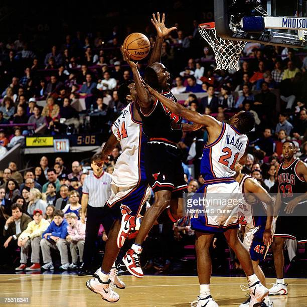 Michael Jordan of the Chicago Bulls attempts a dunk wearing his original Nike sneakers against the New York Knicks during his final game at Madison...