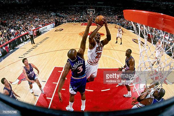 Michael Jordan of the Chicago Bulls attempts a shot against Bryon Russell of the Utah Jazz in Game Five of the 1998 NBA Finals at the United Center...