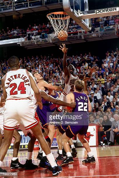 Michael Jordan of the Chicago Bulls attempts a shot against Danny Ainge of the Phoenix Suns in Game Four of the 1993 NBA Finals on June 16 1993 at...