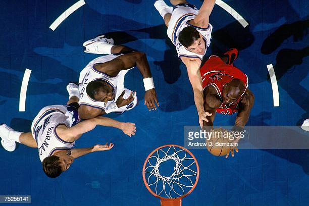 Michael Jordan of the Chicago Bulls attempts a shot against John Stockton and Karl Malone of the Utah Jazz in Game Two of the 1998 NBA Finals at the...