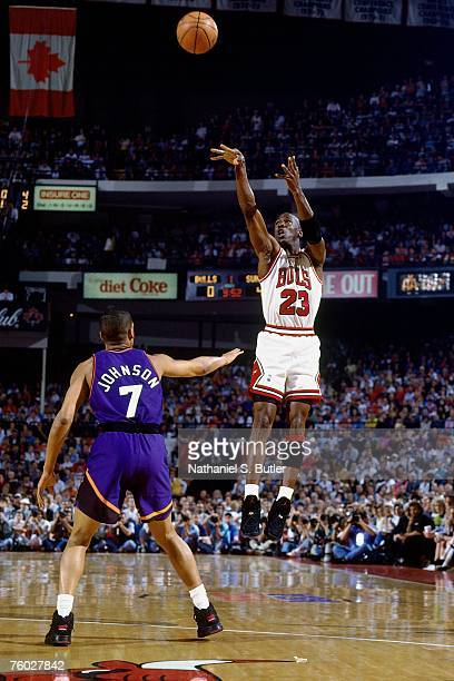 Michael Jordan of the Chicago Bulls attempts a shot against Kevin Johnson of the Phoenix Suns in Game Five of the 1993 NBA Finals on June 18 1993 at...