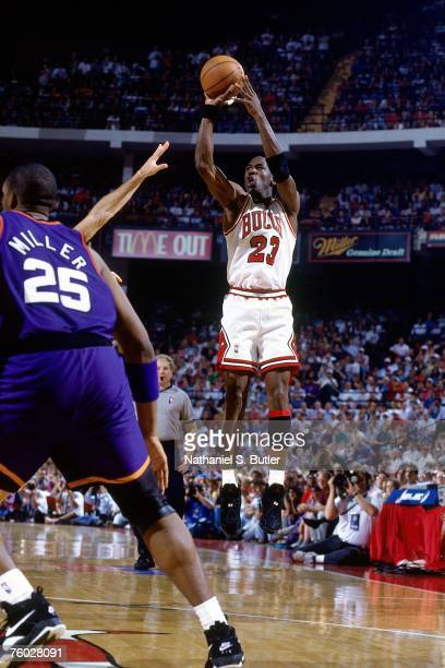 Michael Jordan of the Chicago Bulls attempts a shot against Oliver Miller of the Phoenix Suns in Game Three of the 1993 NBA Finals on June 13 1993 at...