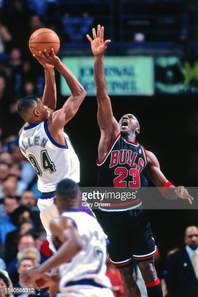 Michael Jordan of the Chicago Bulls attempts to block Ray Allen of the Milwaukee Bucks on January 16 1998 at the BMO Harris Bradley Center in...
