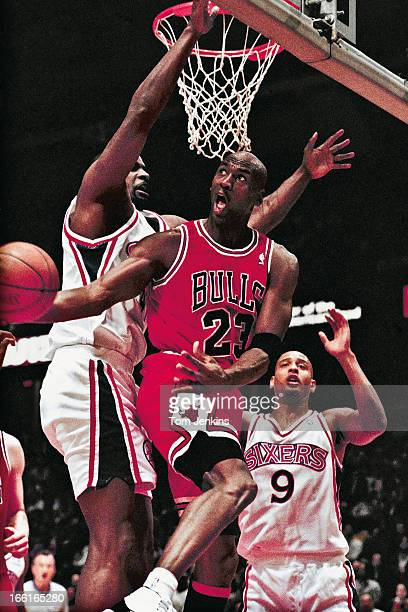 Michael Jordan of the Chicago Bulls basketball team makes a basket from an unusual angle during the match Philadelphia 76ers v Chicago Bulls at the...