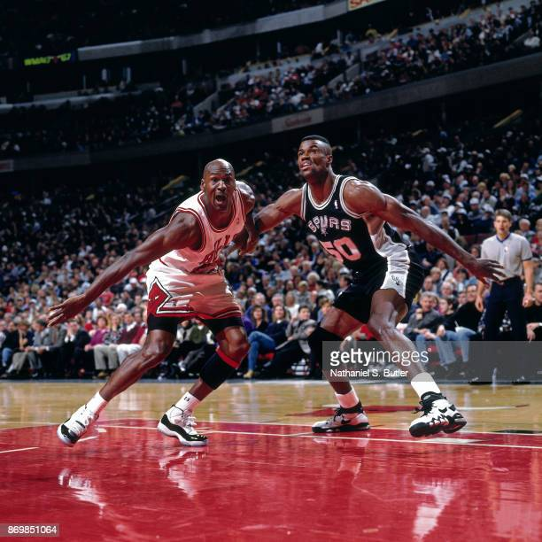 Michael Jordan of the Chicago Bulls battles David Robinson of the San Antonio Spurs for position on December 8 1995 at the United Center in Chicago...