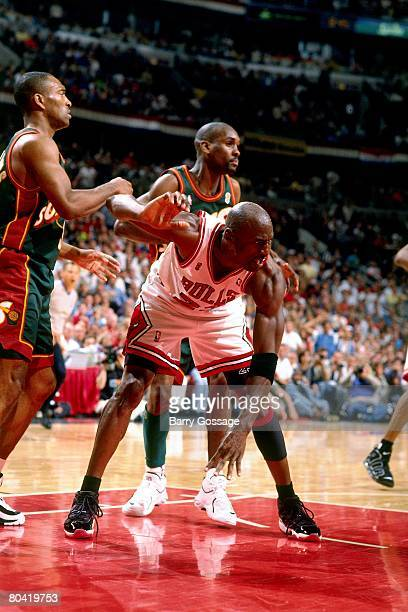Michael Jordan of the Chicago Bulls battles for position against Gary Payton of the Seattle SuperSonics during Game Six of the 1996 NBA Finals at the...