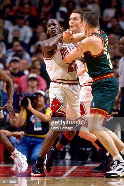 Michael Jordan of the Chicago Bulls battles for position against Frank Brickowski of the Seattle SuperSonics during Game Six of the 1996 NBA Finals...