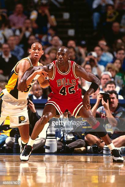 Michael Jordan of the Chicago Bulls battles for position against the Indiana Pacers on March 19, 1995 at Market Square Arena in Indianapolis,...