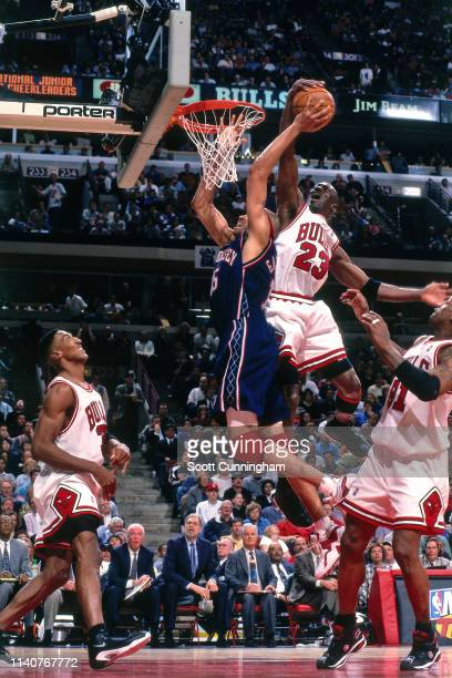 Michael Jordan of the Chicago Bulls blocks the shot of Chris Gatling of the New Jersey Nets during Game One of Round One of the 1998 NBA Playoffs on...