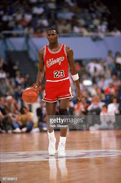 Michael Jordan of the Chicago Bulls brings the ball upcourt against the Los Angeles Clippers during a 198485 season game at the Sports Arena in Los...
