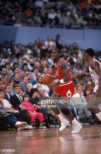 Michael Jordan of the Chicago Bulls brings the ball upcourt against the Los Angeles Clippers during a 1984-85 season game at the Sports Arena in Los...