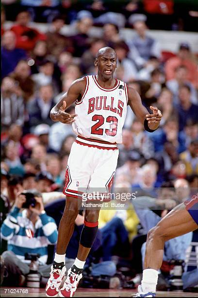 Michael Jordan of the Chicago Bulls calls for the ball against the Detroit Pistons during a game circa 1992 at Chicago Stadium in Chicago Illinois...