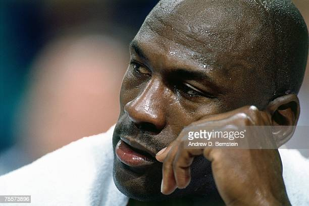 Michael Jordan of the Chicago Bulls catches his breath against the Orlando Magic during Game Six of the 1995 Eastern Conference SemiFinals on May 18...