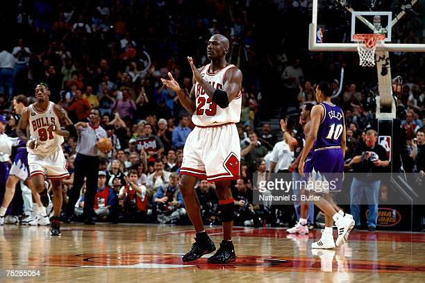 Michael Jordan of the Chicago Bulls celebrates after a play against the Utah Jazz in Game Three of the 1998 NBA Finals at the United Center on June 5...