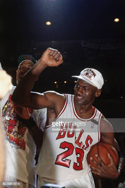 Michael Jordan of the Chicago Bulls celebrates after defeating the Portland Trail Blazers in Game Six of the NBA Finals to win the championship at...