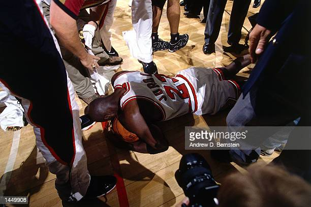 Michael Jordan of the Chicago Bulls celebrates after winning the 1996 NBA Championship against the Seattle Supersonics in Chicago Illinois HIGH...