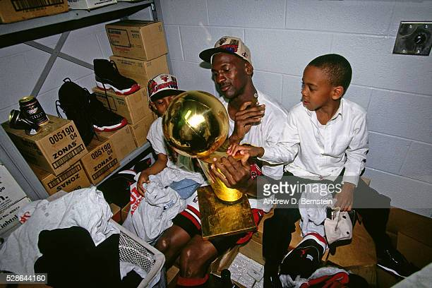 Michael Jordan of the Chicago Bulls celebrates against the Seattle Supersonics during Game Six of the 1996 NBA Finals on June 20 1996 at the United...