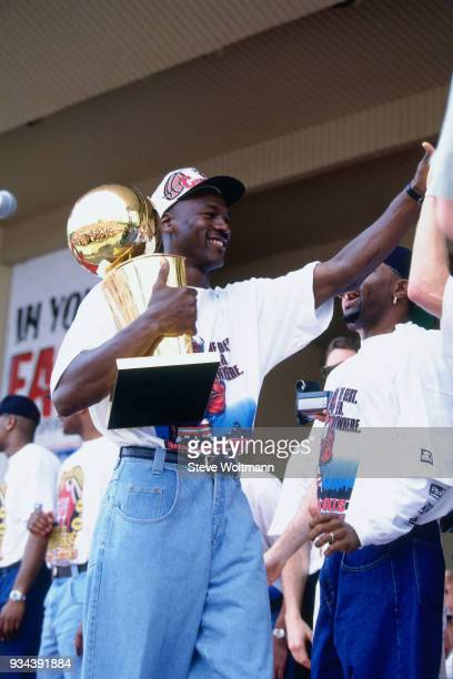 Michael Jordan of the Chicago Bulls celebrates at the Bulls 1996 NBA Championship parade on June 18 1996 in Chicago Illinois NOTE TO USER User...