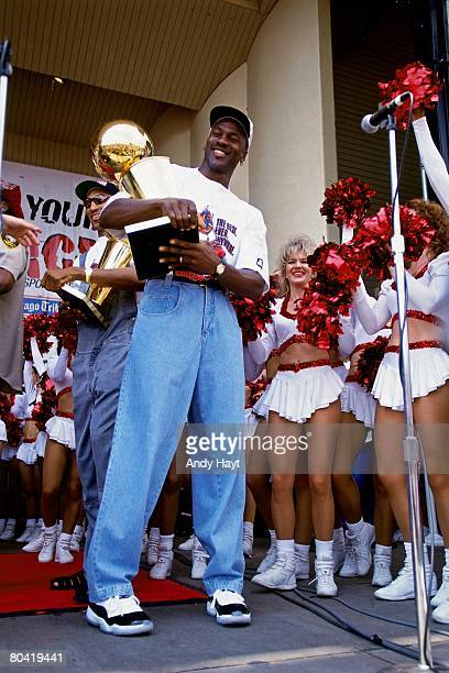 Michael Jordan of the Chicago Bulls celebrates at the Bulls' NBA Championship parade in Chicago Illinois NOTE TO USER User expressly acknowledges...