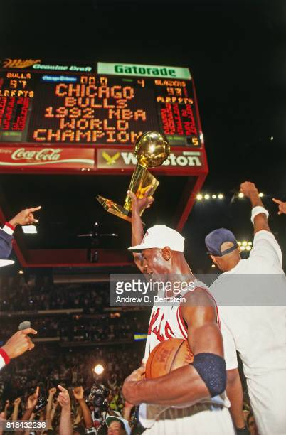 Michael Jordan of the Chicago Bulls celebrates following Game Six of the 1992 NBA Finals on June 14 1992 at Chicago Stadium in Chicago Illinois The...