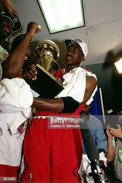 Michael Jordan of the Chicago Bulls celebrates winning the 1993 NBA Championship Finals after winning Game Six against the Phoenix Suns at America...