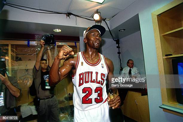 Michael Jordan of the Chicago Bulls celebrates winning the NBA title after defeating the Seattle SuperSonics in Game Six of the 1996 NBA Finals at...