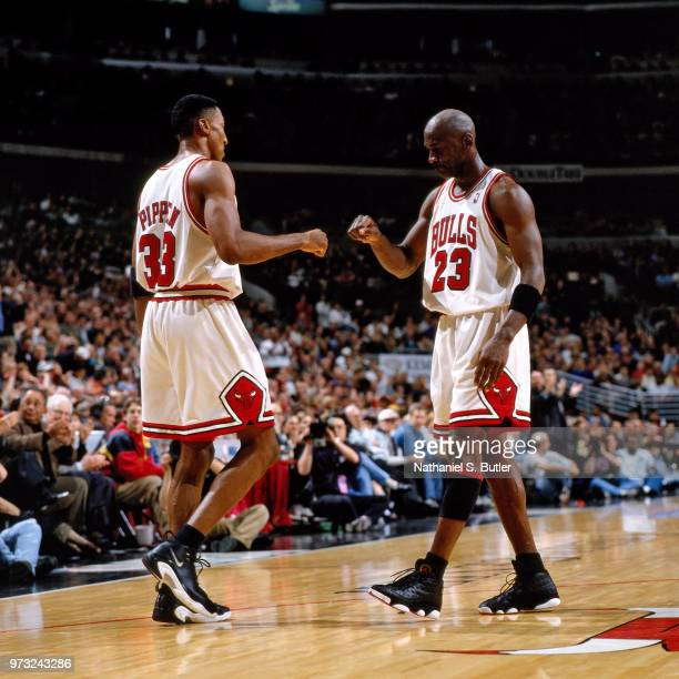 Michael Jordan of the Chicago Bulls celebrates with Scottie Pippen of the Chicago Bulls during a game played on May 3 1998 at the United Center in...