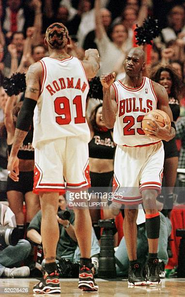 Michael Jordan of the Chicago Bulls celebrates with teammate Dennis Rodman after winning game seven of the NBA Eastern Conference finals against the...