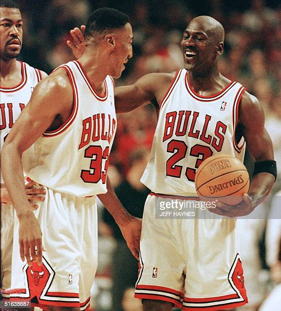 Michael Jordan of the Chicago Bulls celebrates with teammate Scottie Pippen after Pippen had a block against Kendal Gill of the New Jersy Nets 24...