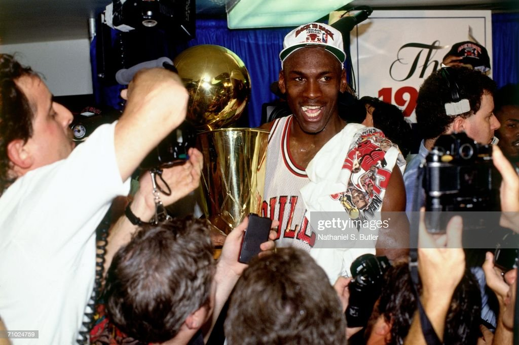 Michael Jordan 23 Of The Chicago Bulls Celebrates With Larry OBrien Trophy
