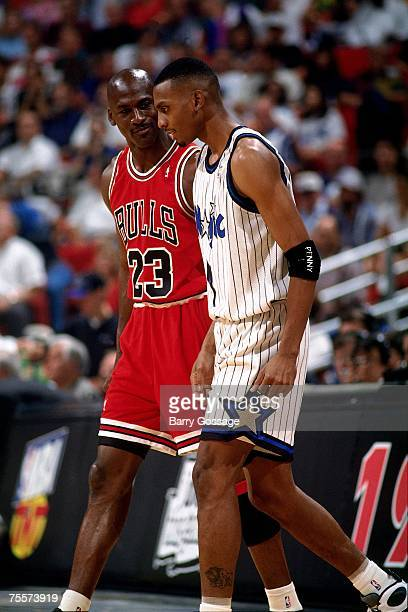 Michael Jordan of the Chicago Bulls chats with Anfernee Hardaway of the Orlando Magic in Game Five of the 1995 Eastern Conference SemiFinals on May...