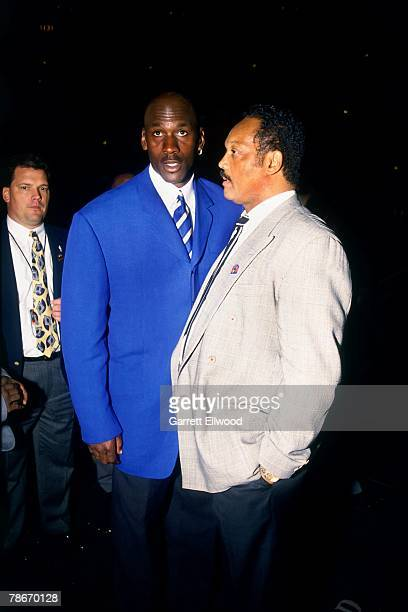 Michael Jordan of the Chicago Bulls chats with Reverend Jesse Jackson prior to taking on the Seattle SuperSonics during Game Two of the 1996 NBA...